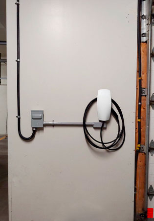 Tesla Wall Connector added in an EV Charging Installation for a condo in Montreal's Mile End