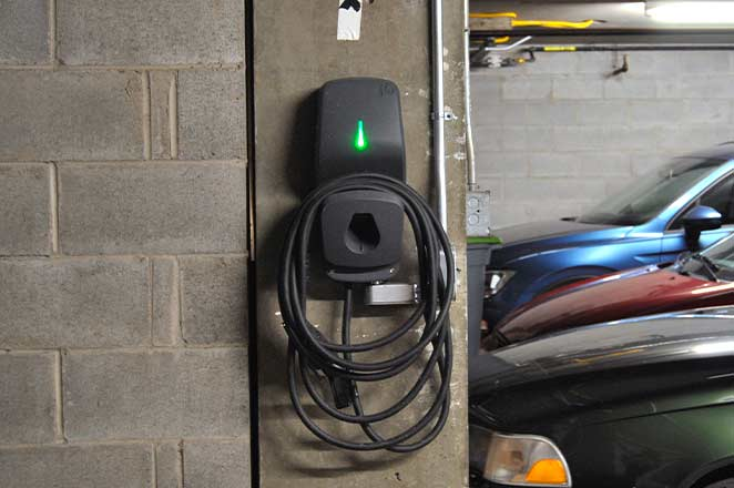 Great photo of a FLO G5 EVSE installed at a condo after learning how to add electric vehicle charging with murbly.com