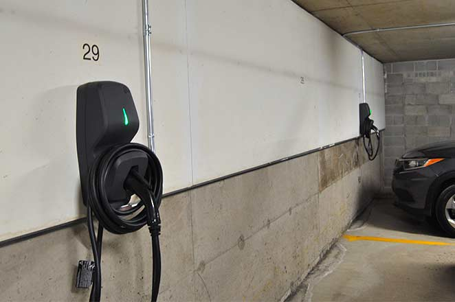 Photo of a FLO G5 EVSE installed at a condo after learning how to add electric vehicle charging with murbly.com.