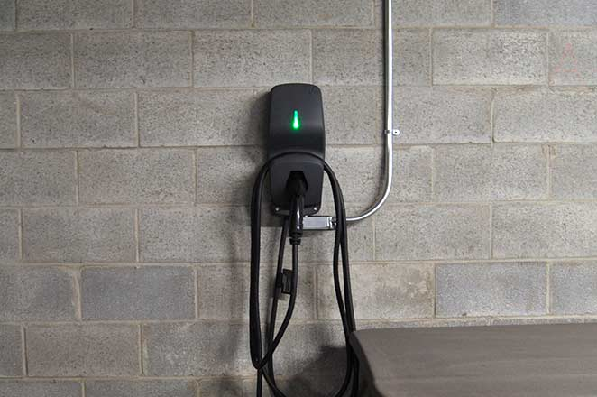 Photo of a FLO G5 installed at a condo after learning how to add electric vehicle charging with murbly.com.
