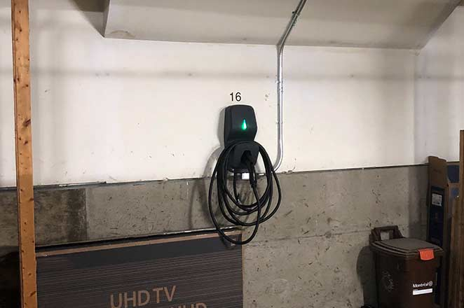 Photo of a FLO G5 installed at a condo after learning how to add electric vehicle charging with murbly.com. This installation is in Saint Henri.