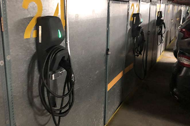 Image for the Victoria and how this condo added electric FLO G5 vehicle charging to their parking stalls in Montreal.